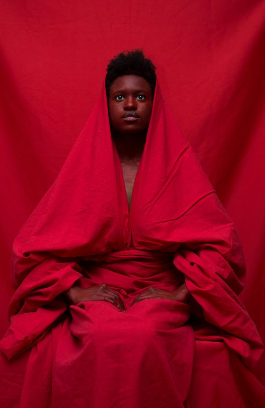 Yannis Davy Guibinga, in Red Woman